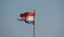 Low Angle View Of Croatian Flag Waving Against Clear Sky