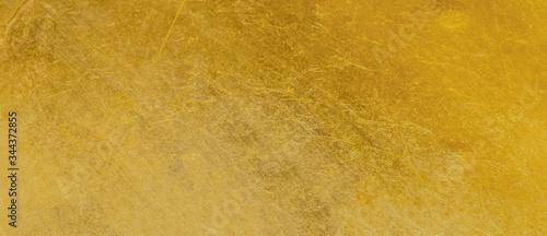 Obraz Gold texture background with yellow luxury shiny shine glitter sparkle of bright light reflection on golden surface - fototapety do salonu