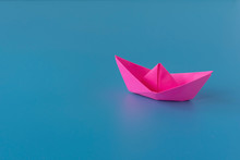 Paper Boat On A Blue Backgroun...