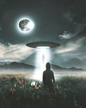 Digital Composite Image Of Man Looking At Ufo Flying Over Field Against Sky