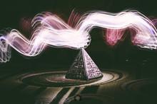 Digital Composite Image Of Illuminated Pyramid At Night