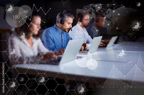 Fotografía Serious call center operators typing on laptops