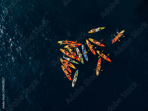 A group of kayakers gathered their kayaks in a heap in sea Canvas-taulu