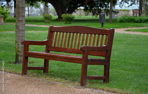 Photo park bench brown with backrest english type beige path thresh lawns wet rain rai