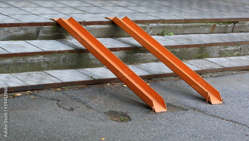 Foto Metal ramp for entry of wheelchairs through the steps