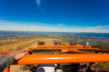 Off Road Orange Truck On Top Mountain And Blue Sky