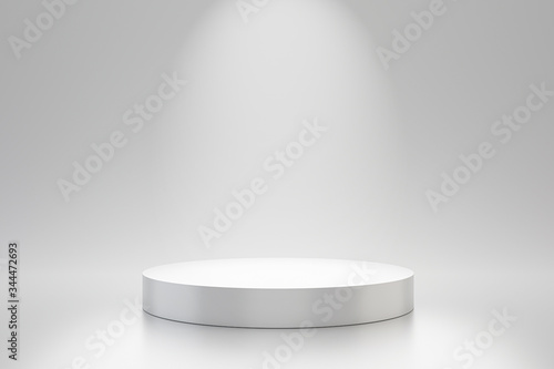 Fotografija White studio template and round shape pedestal on simple background with spotlight product shelf