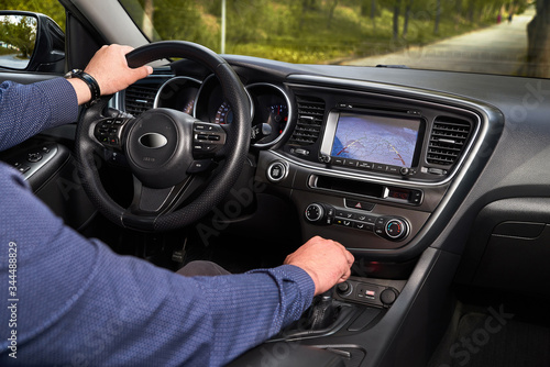 Cuadros en Lienzo Interior of premium car with rearview camera dynamic trajectory turning lines and parking assistant