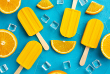 Ice Lollies With Orange Flavour And Ice Cubes