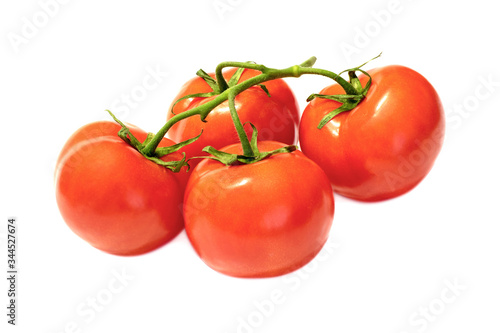 Valokuva branch with red ripened tomatoes on a white background close-up