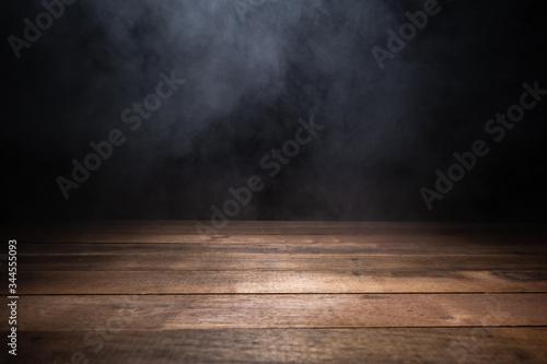 Fototapeta empty wooden table with smoke float up on dark background obraz