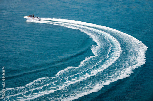 Obraz speedboat runs fast in the open sea and leaves the engine's wake in the water - fototapety do salonu