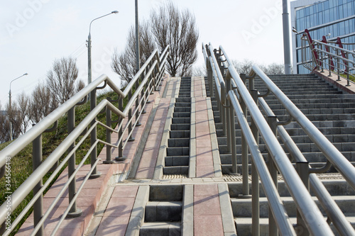 Photo Steps, a staircase with handrails, railings, descent and ascent for people with disabilities and prams, bicycles