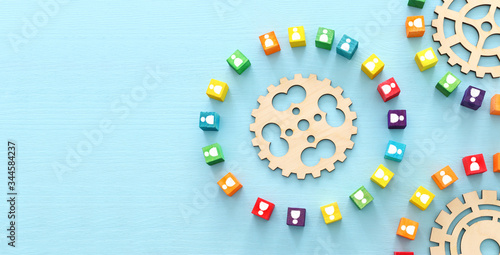 image of colorful blocks with people icons over wooden table ,human resources an Canvas Print