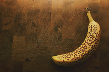 High Angle View Of Banana On Cutting Board