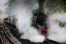 Smoke Coming Out From Steam Train On Railroad Tracks