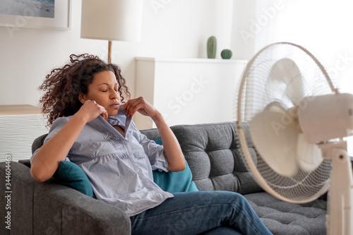 Obraz na plátně Black woman portrait cooling off at home during summer heat