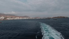 Leaving Tinos Island By Boat Aboard The Ocean At The End Of The Journey. Ocean Wave Splashes Out Strong Hit By Boat's Engine.