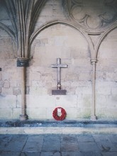 Poppy Wreath In Front Of Memorial At Salisbury Cathedral