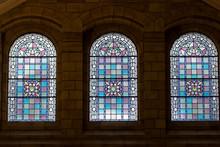 Trio Of Stained Glass Windows. Three Ornate Purple Pink Windows.