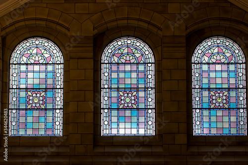 Trio of stained glass windows. Three ornate purple pink windows. Canvas Print
