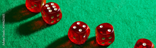 Fotografia High angle view of red dice on green background, panoramic shot