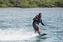 Latino Man Wake Boarding In Costa Rica.