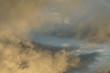 Leinwandbild Motiv Wolken Himmel in gelb und blau nach einem Regen