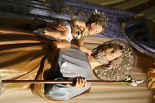 Low Angle View Of Saint Joseph With Infant Jesus Statue In Church