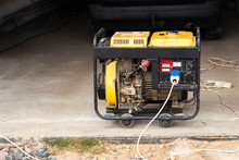 Stand-alone Diesel Generator To Supply Electricity In An Emergency. Yellow Color. Serves Not A Large Residential Building