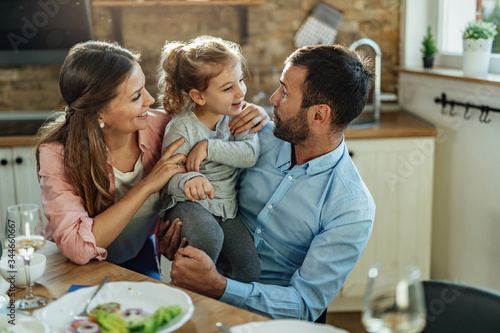 Young happy family having fun at dining table. Canvas Print