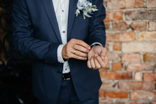 Stylish Young Man Buttoning The Cuff Links On The Sleeves. Style