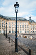 Low Angle View Of Street Light Against Place De La Bourse In City