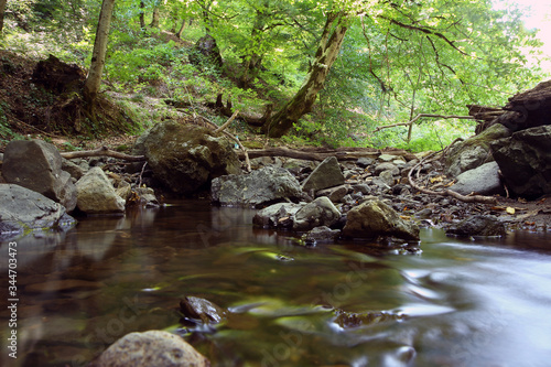 Fototapety, obrazy: Mountain River in the wood . Forest with waterfall deep rain forest and river stream . Fast jet of water at slow shutter speeds give a beautiful fairy-tale effect. River stones . Azerbaijan, Ismayilli