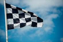 Sport Checkered Flag Against C...