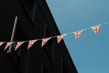 Low Angle View Of American Flags Buntings Against Sky