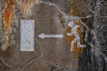Pedestrian Crossing Sign On Old Wall
