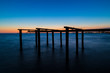 Silhouette Pier In Sea Against Sky During Sunset