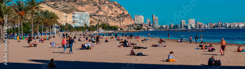 panoramic beach with people in sunny day Fototapete