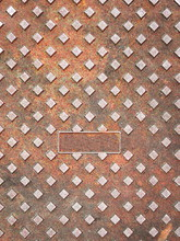 Full Frame Shot Of Rusty Manhole Cover