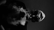 Close-up Of Man Wearing Gas Mask With Smoke