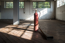 Industrial Fire Extinguisher In An Empty Room