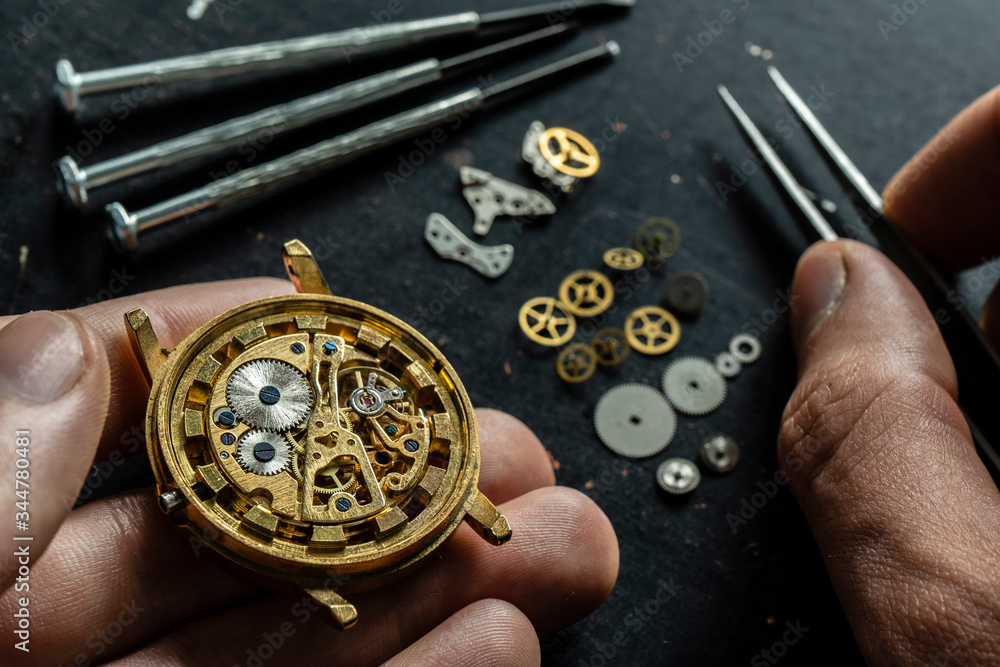 Fototapeta Mechanical watch repair. Watchmaker is repairing the mechanical watches