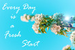 canvas print picture - Every Day is a Fresh Start card. Wild Pear tree blossom. Horizontal banner with white flowers on cyan color blurred sky backdrop with bokeh lights. Nature spring background of blooming fruit branch.