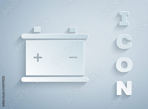 Paper cut Car battery icon isolated on grey background Canvas Print