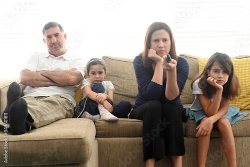 Cuadros en Lienzo Bored family staring at TV screen