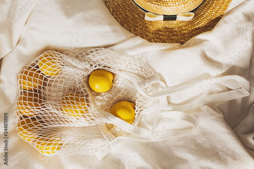 Summer creative flat lay composition with lemon and straw hat Fototapet