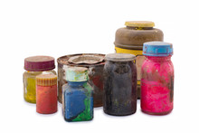 Used Old Color Paints In Different Containers. Glass And Plastic Packaging With Dried Dyes Isolated On White Background