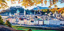 Panoramic Cityscape Of Salzburg, Old City, Birthplace Of Famed Composer Mozart. Colorful Autumn Scene Of  Eastern Alps. Nice Morning Landscape With Salzach River. Traveling Concept Background.