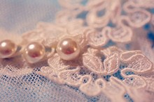 Close-up Of Pearl On Lace
